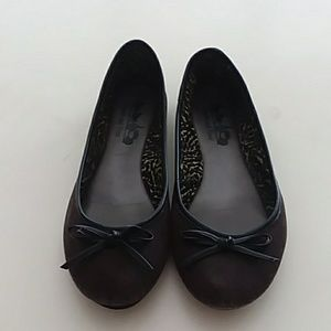 Coach and four size 7.5 black bow ballet flat